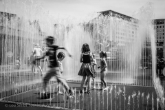 Children Playing in City Water Feature