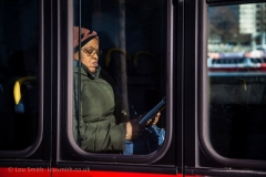 Woman on a London Bus