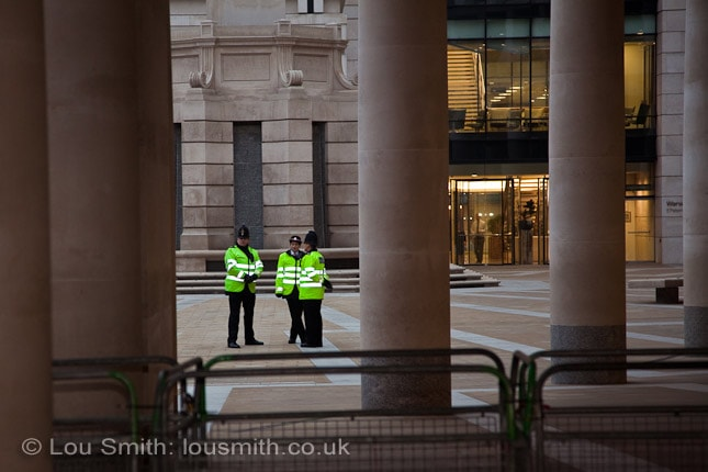 Police in St Paul's Courtyard protect the London Stock Exchange